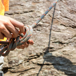 Tying into a climbing harness at Square Ledge in New Hampshire's White Mountains.