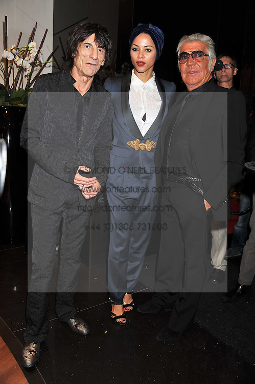 Left to right, RONNIE WOOD, ANA ARAUJO and ROBERTO CAVALLI at a party hosted by Roberto Cavalli to celebrate his new Boutique's opening at 22 Sloane Street, London followed by a party at Battersea Power Station, London SW8 on 17th September 2011.