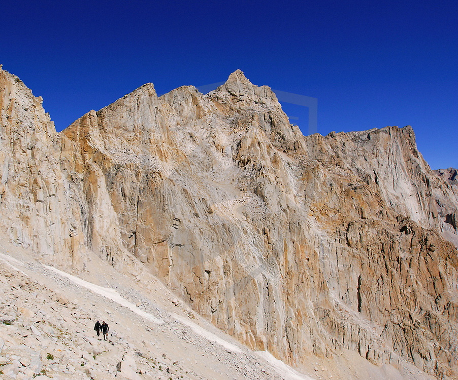 mountain landscape hikers and huge landscape at mount whitney in the sierra nevada mountains of california.