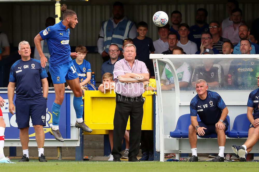 AFC Wimbledon manager Wally Downes watching AFC Wimbledon defender Nesta Guinness-Walker (18) head the ball during the EFL Sky Bet League 1 match between AFC Wimbledon and Rotherham United at the Cherry Red Records Stadium, Kingston, England on 3 August 2019.