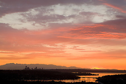 North America, United States, Washington, Seattle, Lake Washington, downtown skyline and Olympic Mountains viewed from Bellevue at sunset