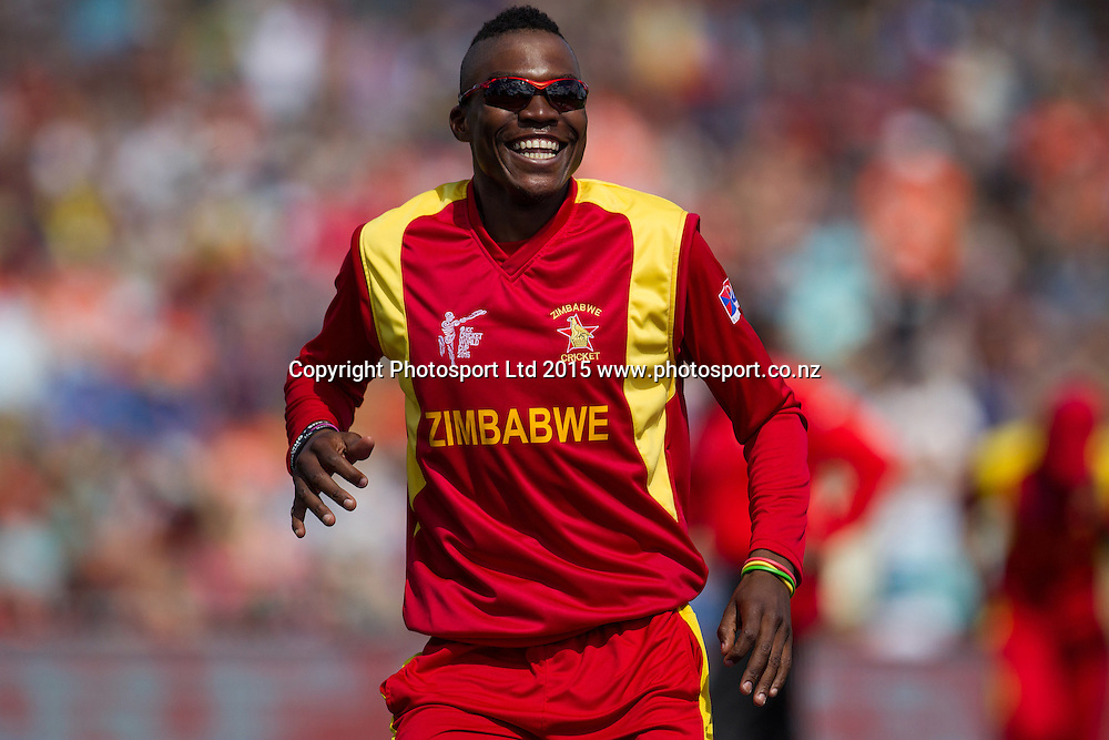 Zimbabwe's Tafadzwa Kamungozi reacts after South African captain AB de Villers is caught off his bowling during the ICC Cricket World Cup match - South Africa v Zimbabwe at Seddon Park, Hamilton, New Zealand on Sunday 15 February 2015.  Photo:  Bruce Lim / www.photosport.co.nz