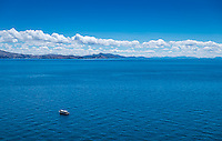 View of lake Titicaca in Peru with typical tourist boat.