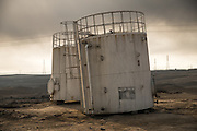Signs of Islamic State are common in Qayyara, which was under the group's control for more than 2 years. The IS flag is seen painted on an old oil tank along the road leading to the oil wells, a road that was littered with IEDs planted by IS militants.