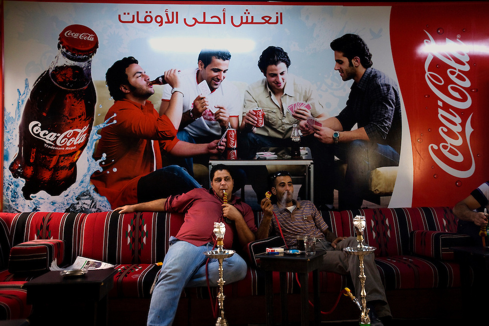 Palestinans smoke narguila pipe At the Eiffel cafe in Ramallah<br /> Photo by Olivier Fitoussi
