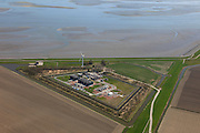 Nederland, Groningen, Gemeente Delfzijl, 01-05-2013; Oostpolderdijk, aanlandingspunt van ondergrondse transportleiding voor gas. Behandelingsstation en gascompressorstation voor aardgas van Gasunietransportservices.<br /> Gas station for debarkation and processing of natural gas.<br /> luchtfoto (toeslag op standard tarieven);<br /> aerial photo (additional fee required);<br /> copyright foto/photo Siebe Swart