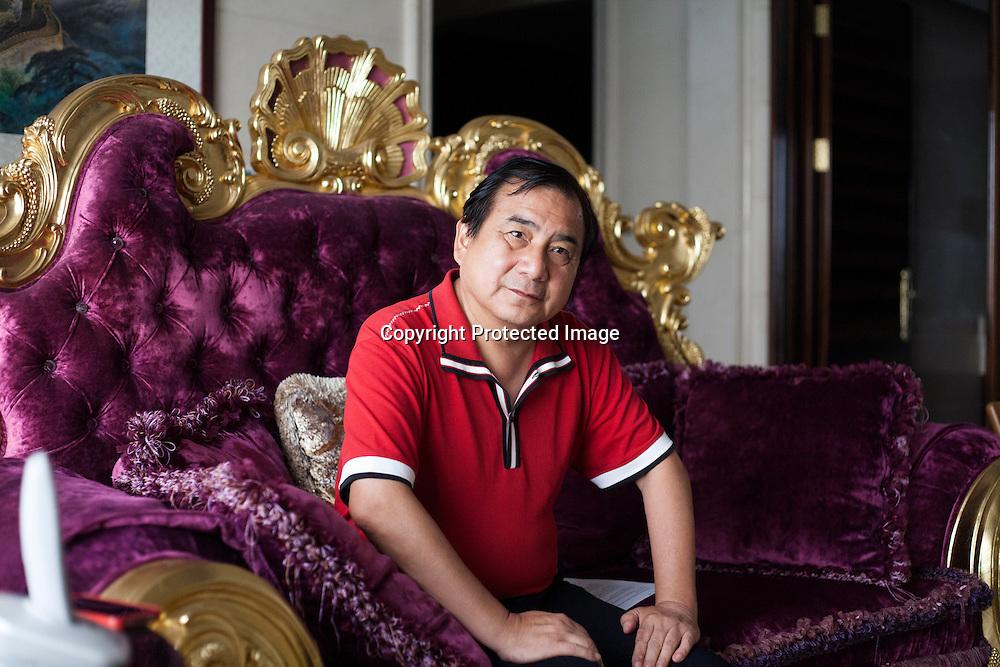 BEJING, JUNE 2013 : Multi -Millionaer Li Xiaohua in seinem Pekinger Penthouse . Li war China's erster Ferrari Fahrer und u.a. das Vorzeigesymbol fuer viele auslaendische Staatsgaeste. Li ist jetzt im Ruhestand und widmet sich hauptsaechlich dem Pekinger Elite Club, der von ihm gegruendet wurde.