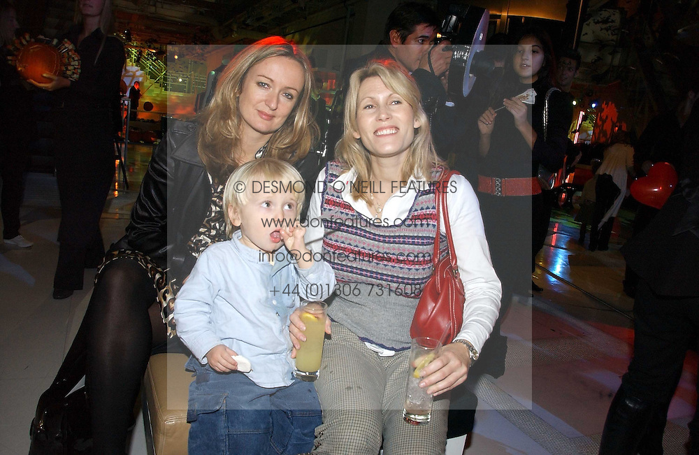 Left to right, LUCY YEOMANS and SAM CORSELLIS with her son GUS CORSELLIS at a party to celebrate the launch of DKNY Kids and Halloween in aid of CLIC Sargent and RX Art held at DKNY, 27 Old Bond Street, London on 31st October 2006.<br /><br />NON EXCLUSIVE - WORLD RIGHTS