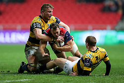 Luke Arscott of Bristol Rugby is tackled by Dan Fish of Cardiff Blues - Rogan Thomson/JMP - 14/10/2016 - RUGBY UNION - Ashton Gate Stadium - Bristol, England - Bristol Rugby v Saracens - EPCR Challenge Cup.