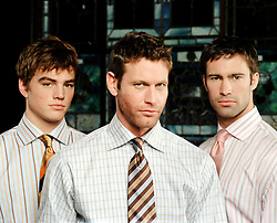 three men in shirts and ties