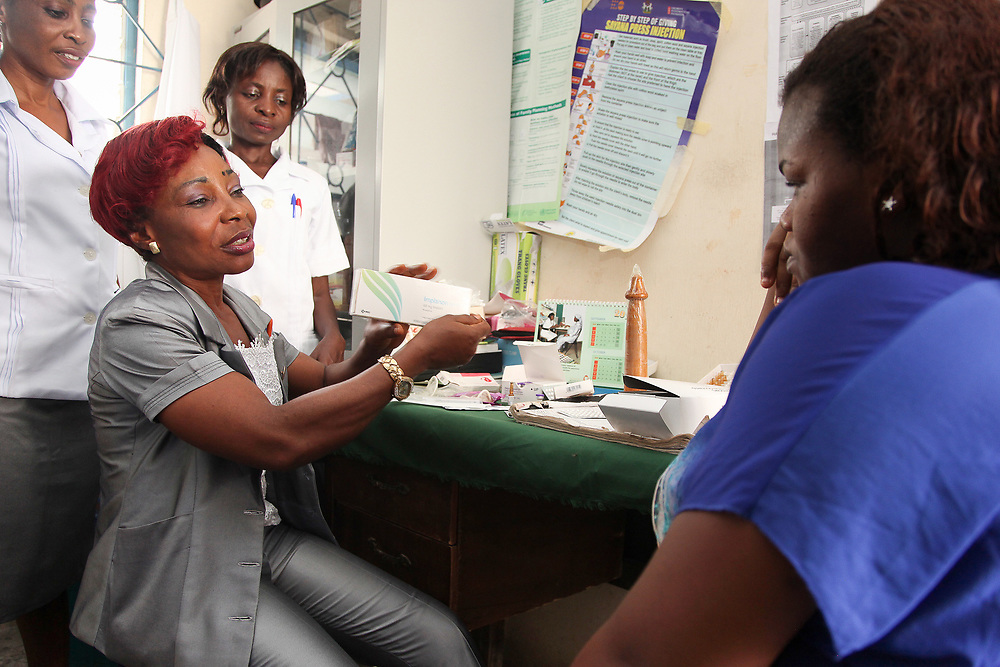 INDIVIDUAL(S) PHOTOGRAPHED: From left to right: Umo Umo Etim, Bassey Immaculata, and Ayene Akong. LOCATION: Epko Abasi Clinic, Calabar, Cross River, Nigeria. CAPTION: The nurses specialized in family planning provide all kinds of information to their beneficiaries on how to correctly use birth control and prevent sexually transmitted diseases.