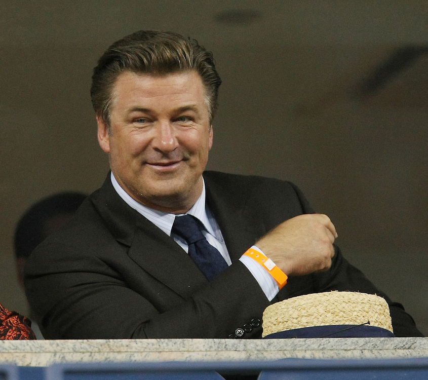 US actor Alec Baldwin sits in the stands before the start of the Carlos Moya of Spain versus Novak Djokovic of Serbia quarterfinals round match on the eleventh day of the 2007 US Open tennis tournament in Flushing Meadows, New York, USA, 06 September 2007.