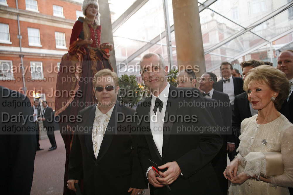 Sir Elton John, Neil Tenant and Lily Safra, Ark Gala Dinner, Marlborough House, London. 5 May 2006. ONE TIME USE ONLY - DO NOT ARCHIVE  © Copyright Photograph by Dafydd Jones 66 Stockwell Park Rd. London SW9 0DA Tel 020 7733 0108 www.dafjones.com