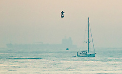 © Licensed to London News Pictures. 04/08/2019. Dover, UK. French inventor Franky Zapata passes a yacht as he heads to St Margarets Bay near Dover as he crosses the English Channel on his jet-powered hoverboard. He made the 35km crossing with a refueling stop mid channel to reach the English coast after setting off at 6:15am French time. Photo credit: Peter Macdiarmid/LNP
