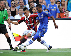 28 July 2012: Chelsea FC Ashley Cole (3) grabs the crotch of AC Milan Stephan El Shaarawy (92) as they fight for the ball during the World Football Challenge as A.C. Milan defeated Chelsea FC 1-0 at Sun Life Stadium in Miami, FL.
