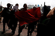 William Estrella, center, and other members of the Black Bloc anarchist group and other protesters march through the streets during the 2012 Republican National Convention on August 27, 2012 in Tampa, Fla.