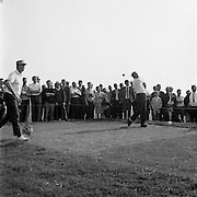 Christy O'Connor (right) drives off the 12th tee with Hugh Boyle on left during the final round of the Irish Dunlop £1,000 Tournament at Tramore Golf Club, Co. Waterford on the 19th August 1967.