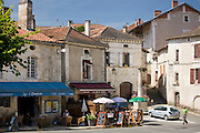 Tourists in quaint town of Bourdeilles popular tourist destination near Brantome in Northern Dordogne, France