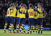 Arsenal players celebrate Arsenal's Tomáš Rosický goal during the The FA Cup match between Brighton and Hove Albion and Arsenal at the American Express Community Stadium, Brighton and Hove, England on 25 January 2015. Photo by Phil Duncan.