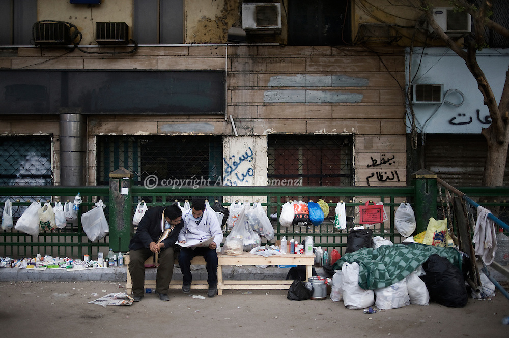 A doctor ad a nurse sit on a bench Tahrir Square in Cairo on February 5, 2011  © ALESSIO ROMENZI