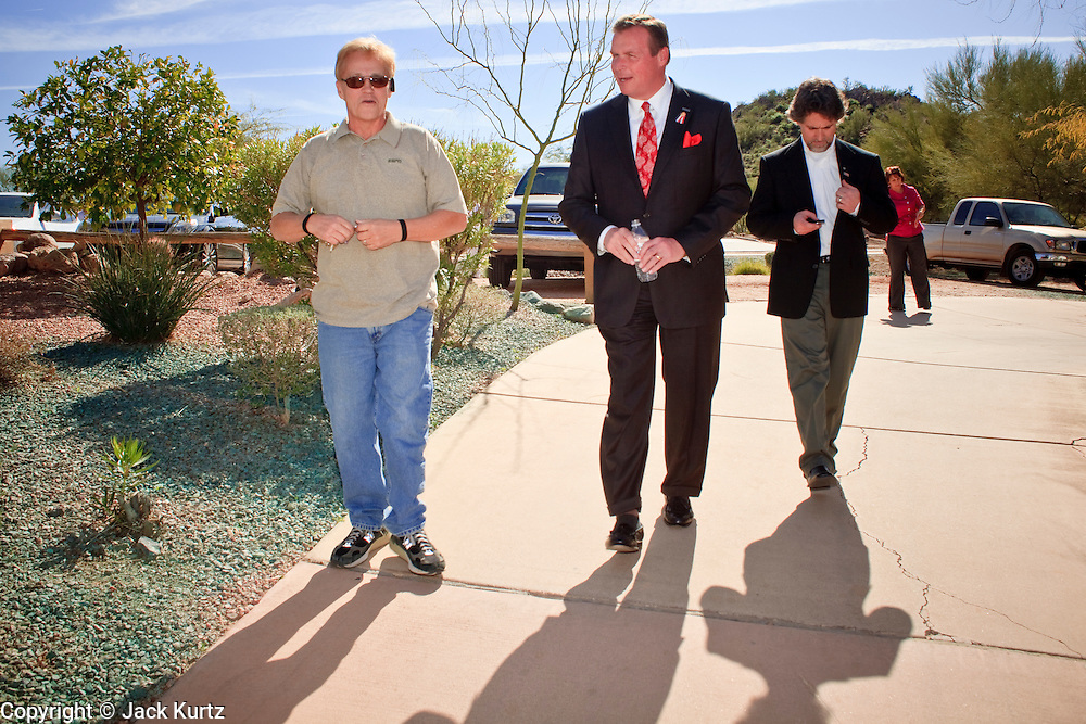 Feb. 17, 2010 -- GOLD CANYON, AZ: JD HAYWORTH, center, walks into his campaign rally in Gold Canyon, AZ. Hayworth, a former television sports anchor and an ultra conservative former Representative who lost his congressional seat to a moderate Democrat in 2006, is running in the Republican primary against long serving Republican Senator John McCain. Hayworth is popular with the Tea Party activists of the Phoenix suburbs.  Photo By Jack Kurtz