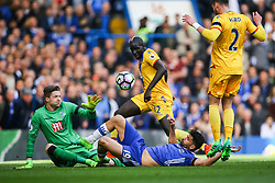 Diego Costa of Chelsea slides in as Wayne Hennessey of Crystal Palace and Mamadou Sakho of Crystal Palace attempt the clear the ball - Mandatory by-line: Jason Brown/JMP - 01/04/2017 - FOOTBALL - Stamford Bridge - London, England - Chelsea v Crystal Palace - Premier League