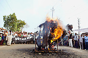 By burning a 'corporate man' statue, an effigy of unregulated, dangerous capitalism and exploitation, Bhopalis are demonstrating in front of the abandoned Union Carbide (now DOW Chemical) industrial complex, site of the infamous 1984 gas tragedy in Bhopal, Madhya Pradesh, central India, on the 29th anniversary since the disaster, December 2, 2013. The poisonous cloud that enveloped Bhopal left everlasting consequences that today continue to consume people's lives.