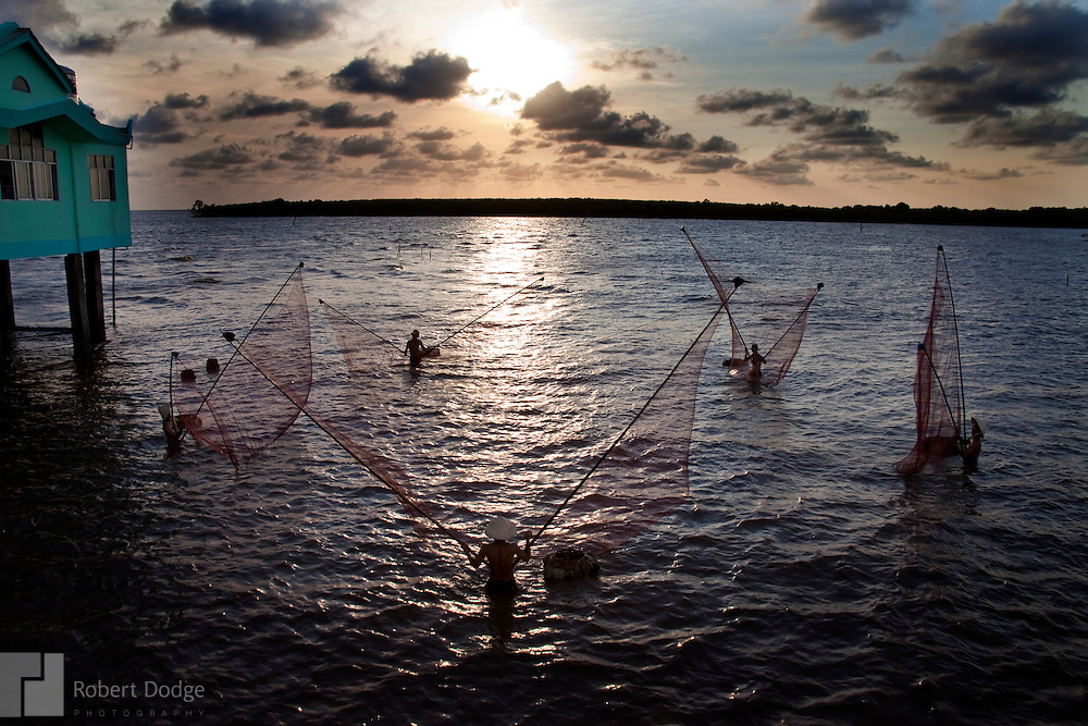 Five fishermen take advantage of the final minutes of light as they fish in the South China Sea at Bac Lieu Province. Robert Dodge, a Washington DC photographer and writer, has been working on his Vietnam 40 Years Later project since 2005. The project has taken him throughout Vietnam, including Hanoi, Ho Chi Minh City (Saigon), Nha Trang, Mue Nie, Phan Thiet, the Mekong, Sapa, Ninh Binh and the Perfume Pagoda. His images capture scenes and people from women in conical hats planting rice along the Red River in the north to men and women working in the floating markets on the Mekong River and its tributaries. Robert's project also captures the traditions of ancient Asia in the rural markets, Buddhist Monasteries and the celebrations around Tet, the Lunar New Year. Also to be found are images of the emerging modern Vietnam, such as young people eating and drinking and embracing the fashions and music of the West. His book. Vietnam 40 Years Later, was published March 2014 by Damiani Editore of Italy.