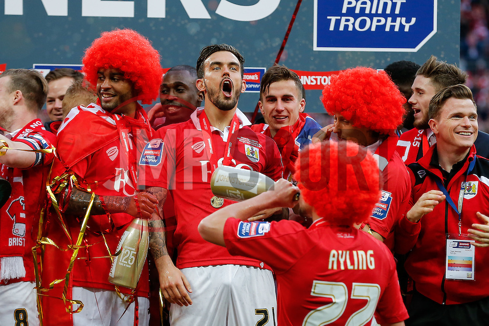 Marlon Pack celebrates as Bristol City players lift the Football League Trophy after thay win the match 2-0 - Photo mandatory by-line: Rogan Thomson/JMP - 07966 386802 - 22/03/2015 - SPORT - FOOTBALL - London, England - Wembley Stadium - Bristol City v Walsall - Johnstone's Paint Trophy Final.