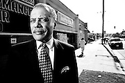 Councilmember Bernard Parks, in front of 2514 Vernon Ave.  Body of Hennetta Wright was found in alley behind building.