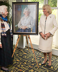 In the image - The Duchess with a portrait painted by Ruth Heppel.<br /> HRH The Duchess of Cornwall, Patron of Helen & Douglas House Hospice visits Douglas House to celebrate their 10th Anniversary. The Hospice cares for children and young adults with life shortening conditions, United Kingdom, Friday, 9th May 2014. Picture by i-Images