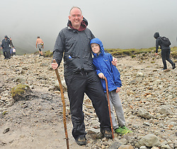 Eoin Clenihan aged 9 with his dad Sean from Craigavon Co Armagh on Croagh Patrick on reek sunday.<br /> Pic Conor McKeown