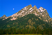 Full moon over the Cathedral Group.  Grand Teton National Park.  Wyoming, USA
