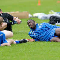 St Johnstone Signings....26.06.12<br /> New St Johnstone signing pictured during training Gregory Tade talking to Steven Anderson<br /> Picture by Graeme Hart.<br /> Copyright Perthshire Picture Agency<br /> Tel: 01738 623350  Mobile: 07990 594431