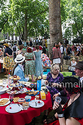 People enjoying themselves at at the Chap Olympiad. 2014. An annual event celebrating Britain's sporting ineptitude. Bedford Square, London