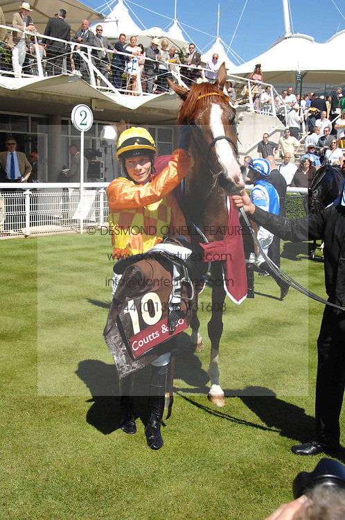 """Winner of the Coutts Glorious Stakes """"Purple Moon' and jockey JAMIE SPENCER at the 4th day of the Glorious Goodwood racing festival 2007 held at Goodwood Racecourse, West Sussex on 3rd August 2007.<br /><br />NON EXCLUSIVE - WORLD RIGHTS"""