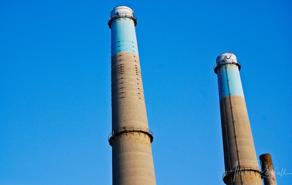 The natural gas power plant at Moss Landing, exhaust stacks against a blue sky