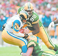 (Published caption 11/10/97) Packers' Gabe Wilkins (98) and Santana Dotson converge on Rams quarterback Mark Rypien for a sack Sunday. Green Bay sacked St. Louis QBs four times.