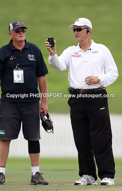 Sky TV rep and umpire Tony Parker checks the light.<br />Day 4. Test match cricket. One off test.<br />New Zealand Black Caps versus Bangladesh.<br />Seddon Park, Hamilton, New Zealand.<br />Thursday 18 February 2010.<br />Photo: Andrew Cornaga/PHOTOSPORT