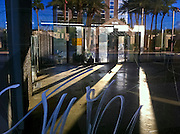 20 NOVEMBER 2011 - PHOENIX, AZ: A homeless man sleeping behind a closed business building on N Central Ave, in Phoenix, AZ.   PHOTO BY JACK KURTZ
