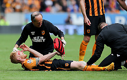 Hull City's Paul McShane receives treatment for a head injury caused by Marouane Fellaini of Manchester United  - Photo mandatory by-line: Matt McNulty/JMP - Mobile: 07966 386802 - 24/05/2015 - SPORT - Football - Hull - KC Stadium - Hull City v Manchester United - Barclays Premier League