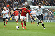 Derby County defender Richard Keogh (captain) holds on to the shirt of Nottingham Forest midfielder Ryan Mendes during the Sky Bet Championship match between Derby County and Nottingham Forest at the iPro Stadium, Derby, England on 19 March 2016. Photo by Jon Hobley.