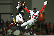 Mavel defensive back Uryan Hudson, Jr. (13) breaks up a pass intended for Pearland wide receiver Ryan Diaz (10) in the Mavericks' 34-32 win over the Oilers on Friday, Nov 7, 2014.  (Photo/Olyn D. Taylor)