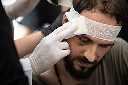 © Licensed to London News Pictures. 10/08/2020. Beirut, Lebanon. An injured man has his wounds tended to during the aftermath around Beirut city centre following an explosion in Beirut port on Tuesday 4 August. Photo credit : Tom Nicholson/LNP