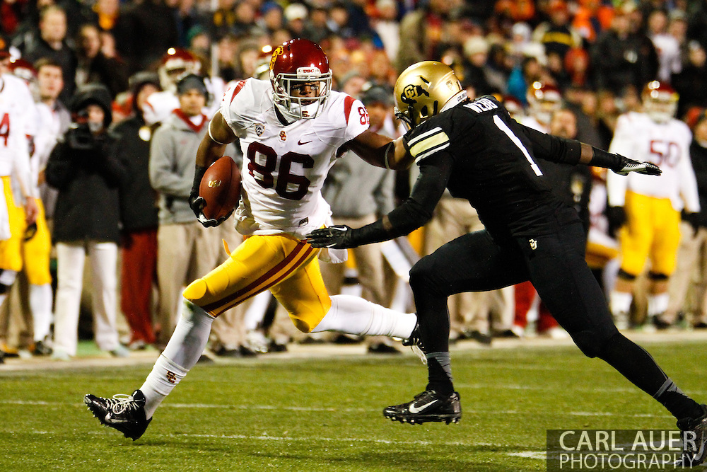 November 23rd, 2013:  USC Trojans junior tight end Xavier Grimble (86) attempts to get past Colorado Buffaloes senior inside linebacker Derrick Webb (1) in first quarter action of the NCAA Football game between the University of Southern California Trojans and the University of Colorado Buffaloes at Folsom Field in Boulder, Colorado