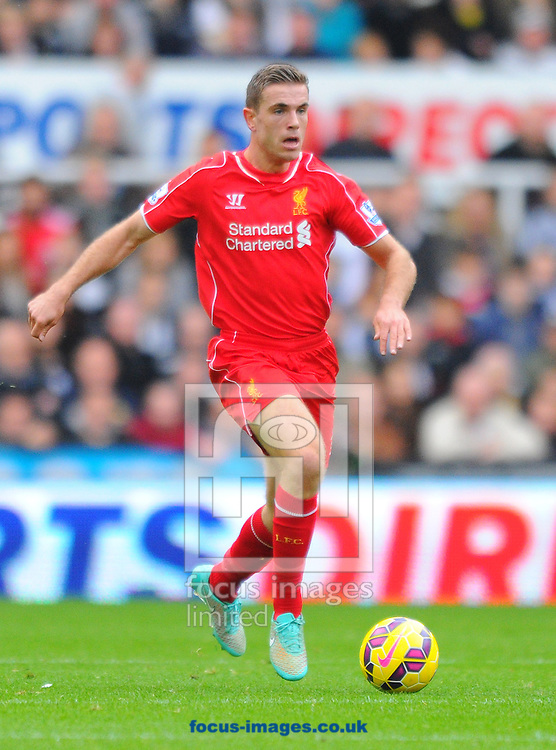 Jordan Henderson of Liverpool controls the ball during the Barclays Premier League match at St. James's Park, Newcastle<br /> Picture by Greg Kwasnik/Focus Images Ltd +44 7902 021456<br /> 01/11/2014