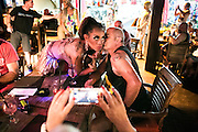 Alena gets a kiss from a guest of the restaurant during a dragqueen perfomance in Bali, Indonesia.