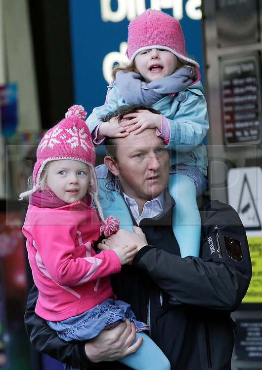 © Licensed to London News Pictures. 20/12/2011. London, United Kingdom .Andrew Clarke, who is in the Army, with two of his children, Violet, 4, (in pink) and Margot, 2, show support for his wife Alice who is in the Military Wives Choir.The choir sing to the public HMV on Oxford Street to celebrate the success of their single..Photo credit : Chris Winter/LNP