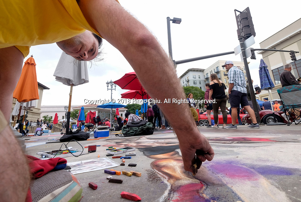 26th annual Pasadena Chalk Festival held in Los Angeles<br /> <br /> An artist works on his piece during the 26th annual Pasadena Chalk Festival in Los Angeles, the United States, June 18, 2018. The Festival feature more than 600 artists using 25,000 sticks of pastel chalk to create life-size 200 murals on the city pavement.  (Xinhua/Zhao Hanrong)<br /> (Photo by Ringo Chiu)<br /> <br /> Usage Notes: This content is intended for editorial use only. For other uses, additional clearances may be required.