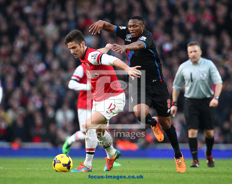 Picture by Paul Terry/Focus Images Ltd +44 7545 642257<br /> 02/02/2014<br /> Olivier Giroud of Arsenal breaks away from Kagisho Dikgacoi of Crystal Palace during the Barclays Premier League match at the Emirates Stadium, London.